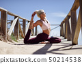 Caucasian blonde woman practicing yoga in the 50214538