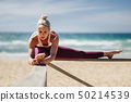 Caucasian blonde woman practicing yoga in the 50214539
