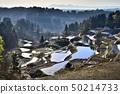 Niigata Matsushiro Yayoi Echigo Miyama in the snow covered terraced fields 50214733