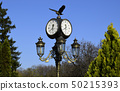 Clock on a street lamp. Ukraine, Kharkov, Feldman 50215393