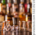 Traditional pure vodka in glasses on a black 50219210