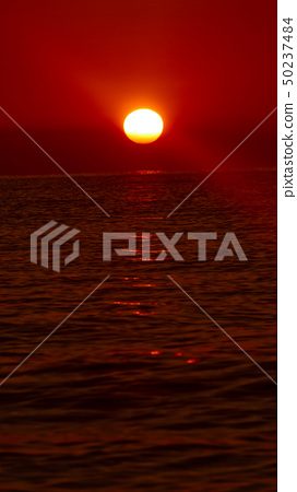 Sun shine in the morning over the sea. 50237484