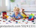 Kids play with toy cars. Children playing car toys 50241331