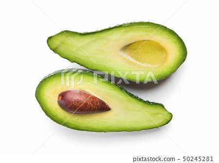 Two halves of ripe avocado 50245281