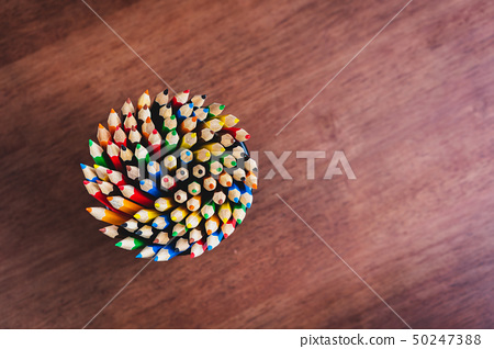 Multiple colored pencils in the box on the table. 50247388