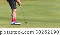 Playing golf preparing to shot 50262190