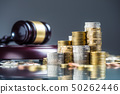 Towers with euro coins and justice hammer in the 50262446