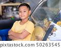 Asian kid boy waiting at bakery shop and choosing 50263545