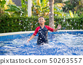 Happy asian kid boy swiming on swiming pool in the 50263557