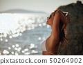 Bikini girl on the beach. woman in bikini on the 50264902