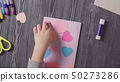 Girl's hands glueing a card. Mother's Day 50273286