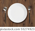 Old wood dish dish with spoon and fork 50274923
