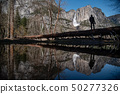 Photographer standing in Yosemite national park 50277326