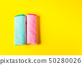 Colorful microfiber cloths on bright yellow 50280026
