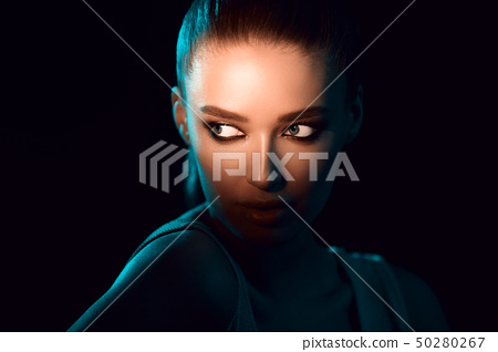 Woman In Shadow. Eyes under bright light 50280267