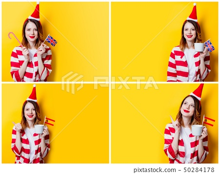 redhead woman in Santa Claus hat and striped shirt with Spain and UK flags 50284178