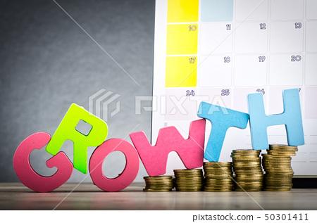 word GROWTH spelled using wooden alphabet on desk 50301411