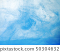 Blue acrylic ink dissolving into water, close up 50304632