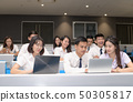 Group of students working with laptop in classroom 50305817