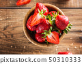 Juicy washed strawberries in wooden bowl on 50310333
