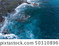 Aerial view to ocean waves. Blue water background. 50310896