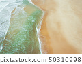 Aerial view of sandy beach and ocean with waves. 50310998