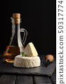 Brie cheese or camembert on stone board with knife 50317774