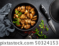 Fried mushrooms, champignons in pan 50324153