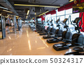 Treadmill in sport gym interior and fitness health 50324317