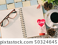Top view image of empty notebook,spectacles and 50324645