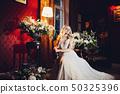Sensuality blondie bride sitting on chair in 50325396