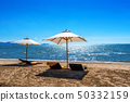 Chairs and umbrella on a tropical beach. 50332159