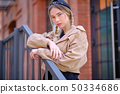 Amazing Beautiful young woman in a beige jacket 50334686