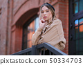Amazing Beautiful young woman in a beige jacket 50334703