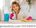Beautiful blonde woman looking at the counter surface 50339050