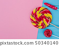 Set of lollipops on color paper background. 50340140