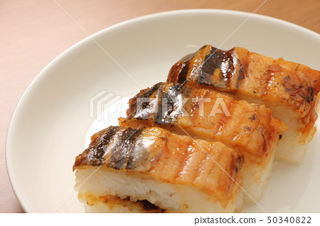 Grilled conger eel and sushi. 50340822