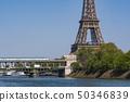 Paris metro crossing Pont de Bir-Hakeim and Eiffel Tower 50346839