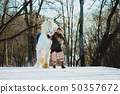 Man in suit of ancient warrior walking with the big white horse 50357672