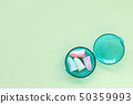Earplugs in a box on the green background. 50359993