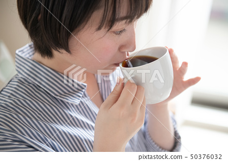 Young Japanese Woman Drinking Hot Coffee 50376032