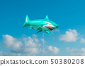 Shark balloon flying in blue sky 50380208