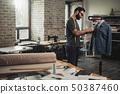 Fashion designer working in his studio 50387460
