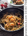 Pasta spaghetti on plate and pan with shrimp 50387768