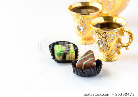 Still life with traditional golden arabic coffee 50390475