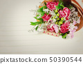 Fresh, lush bouquet of colorful flowers on white 50390544