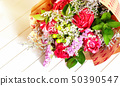 Fresh, lush bouquet of colorful flowers on white 50390547