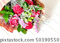 Fresh, lush bouquet of colorful flowers on white 50390550