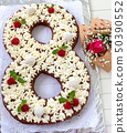 Big number cake and red rose flower. Cake shape of 50390552