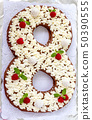 Big number cake shape of 8 decorated white 50390555